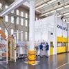 Volkswagen produziert Teilkomponenten von Elektromotoren auf Schuler-Anlage