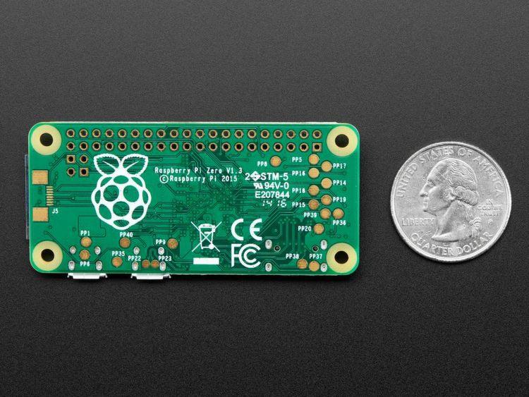 Raspberry Pi Zero: Der kleinste Pi im Vergleich mit einer Münze (hier die Variante ohne Kameraport