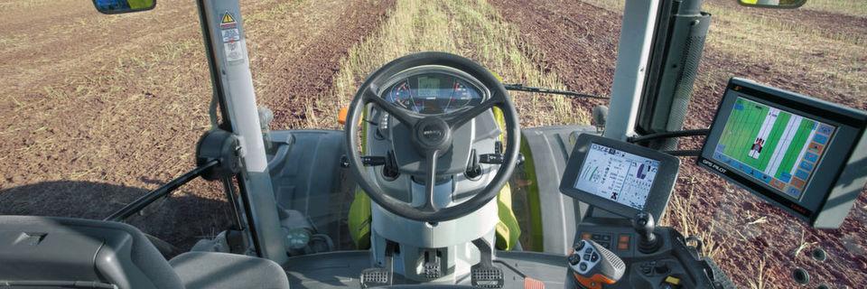 Moderne Landwirtschaft: Die Fahrerkabinen sind heutzutage mit zahlreichen unterstützenden Systemen ausgestattet wie Displays, Joysticks und GPS-Verbindung.