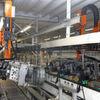 Robotergestützte Bestückung einer Lackieranlage für Stahlfelgen