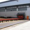 Automatisierte Rollenbahn-Strahlanlage für Bleche, Profile und Rohre