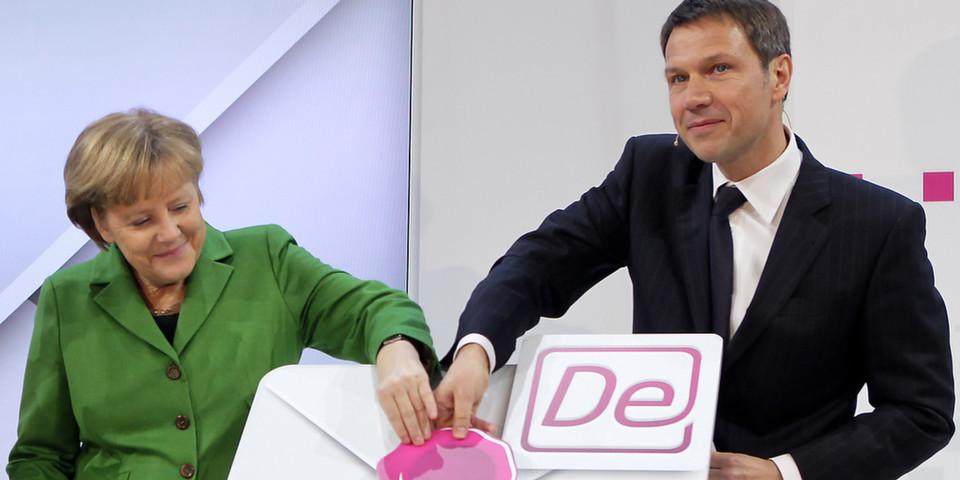 Bundeskanzlerin Angela Merkel und Telekom-Chef René Obermann