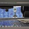Wasserstrahl-Schneidsysteme mit Lasertracker justieren
