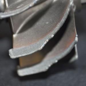 Aufgetragenes Material am reparierten Werkstück