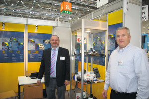 "Rudolf Müller, Sales Engineer Europe, (left) and Edward Seaman, Vice President Sales, promote their huge range of external power supplies for the medical market, including ""green"" power supplies meeting Level V requirements."