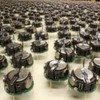 A robot swarm which assembles into complex shapes