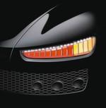 Red Dot Award 2015 - Fahrzeugrückleuchte von Hersteller Automotive Lighting Reutlingen: Die Gestaltung dieser externen Rückleuchte basiert auf organischen LEDs (OLEDs), die nicht nur im Fahrzeuginnenraum, sondern auch bei der Heckbeleuchtung eingesetzt werden können. Die flachen und dünnen Module geben mit ihrer gesamten Fläche ein homogenes Licht ab, überhitzen nicht und sparen Energie. Die Lichtquellen in Rot und Gelb folgen elegant der Außenkontur der Karosserie und fügen sich damit harmonisch in die Linienführung des Fahrzeugs ein. Im ausgeschalteten Zustand überzeugen die OLED-Elemente mit ihrem sehr eleganten, spiegelähnlichen Erscheinungsbild.