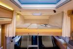 Auch nicht kletterfrei: Quer eingebautes Hubbett im Dethleffs Globebus.