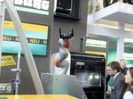 At Fakuma 2015, Arburg showed more than just the Freeformer on its own. Instead the company combined the Freeformer with its Allrounder injection molding machines as part of a cell. One highlight: A very flexible automation system showing a six-axis Kuka robot loading and unloading a Freeformer.