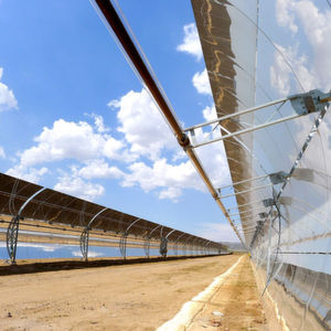 Concentrated solar power technologies (CSP) use parabolic trough collectors to concentrate sunlight onto vacuum receivers filled with heat-transfer fluid.