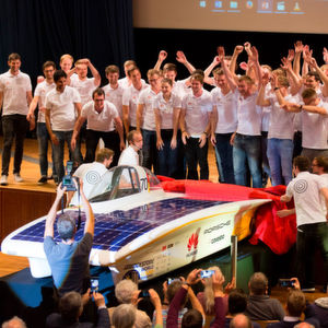 The Sonnenwagen team comprising 40 students celebrate the unveiling of the solar race car in the main building of RWTH Aachen University, Germany.