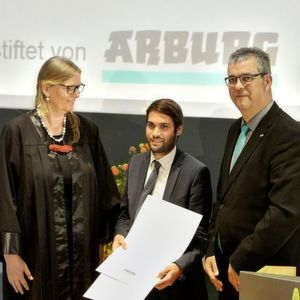 Dr Andreas Schmideder (centre) won the award for best dissertation, presented by award coordinator Professor Birgit Vogel-Heuser and Michael Vieth, Arburg's apprenticeship manager.
