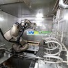Robot in washing cell in the automotive industry