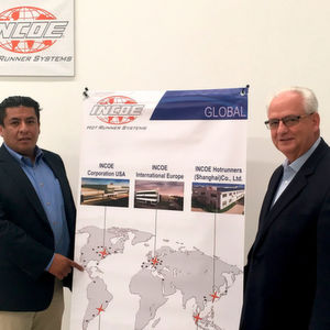 Incoe USA General Manager Kurt Curtis (r) and Isaac Gomez, proudly showing Incoe Mexico on Incoe's global map.
