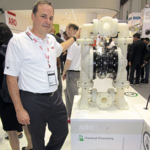 Aro's global product manager, Julien Bassett, standing next to the new EXP Series 3-in. diaphragm pump.
