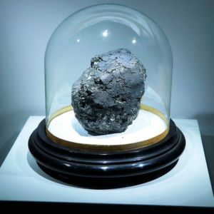 The Orgueil carbonaceous meteorite, a scientific treasure that fell in 1864 in southwest France. The main mass of the meteorite can be seen at the meteorite exhibit at the Muséum National d'Histoire Naturelle in Paris until January 2019. The stand on which the meteorite is displayed is about 30 cm across.