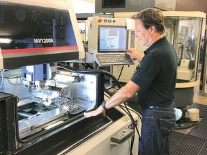 Marcus Alexander on the Mitsubishi wire EDM machine MV1200-R with integrated B-axis from MMK Matsumoto.