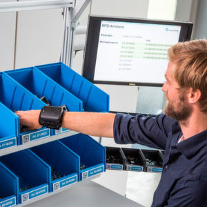 An RFID wristband developed by Fraunhofer IFF for Processes in Intralogistics illustrates how information for Big Data systems can be collected.