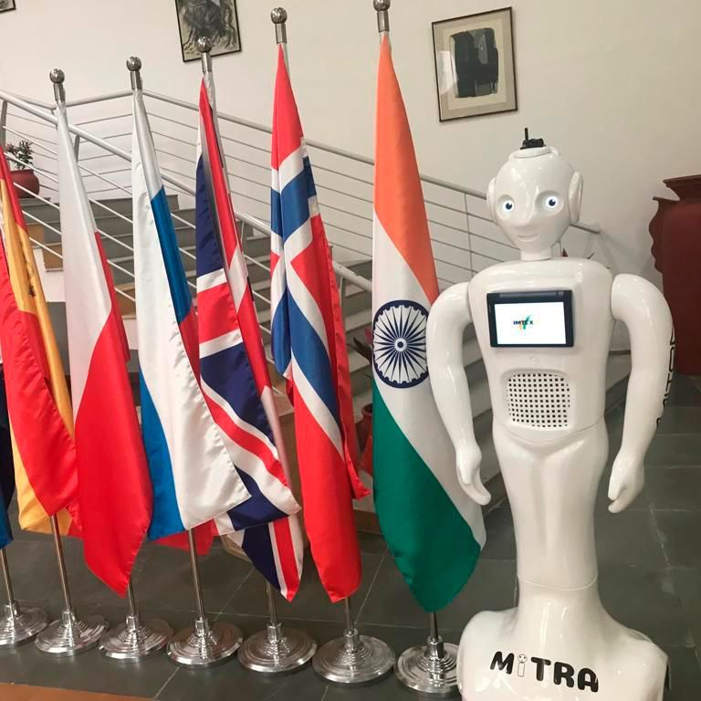 The 5 foot tall 'Mitra' robot is programmed to welcome customers and interact with them using