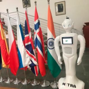 The 5 foot tall 'Mitra' robot is programmed to welcome customers and interact with them using facial and speech recognition, contextual help and autonomous navigation.
