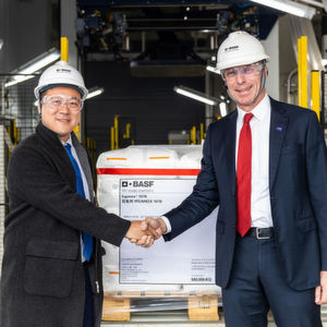 During the opening ceremony for the second phase of BASF's new, world-scale antioxidants plant in Shanghai, China, Daniel Wang (left), Procurement Manager of Borouge, receives the first pallet of Irganox 1076 from Hermann Althoff, Senior Vice President, Performance Chemicals Asia Pacific, BASF.