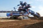 Fig. 1: Sandvik's compact bucket wheel excavator delivered to Hungary has a total height of 24 metres and a total weight of 1650 tonnes. The 12 metre diametre bucket wheel delievers 6700 cubic meter per hour of loose material – a total capacity of 12 million bank cubic metres and tonnes per year.