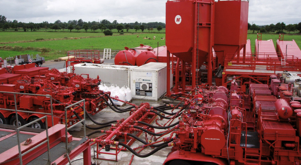 Wellhead with fracking equipment at a drill site.