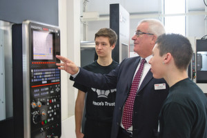 Yamazaki Mazak Product Manager John Liverton shows two local young people the ropes.