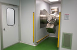 The Criox system can also be mounted through a wall, so that the machine itself is in a dedicated enclosure and only the loading hopper extends into the cleanroom.
