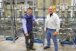"EMCO Chemical Distributors Vice President of Engineering B.J. Korman (left) and Facilities Maintenance Manager Mark Serdar chose Wilden Advanced Fit Series AODD Pumps for the ""warm room"" at the company's new facility in Pleasant Prairie, WI, USA. The warm room is used to load, unload and store temperature-sensitive chemicals."