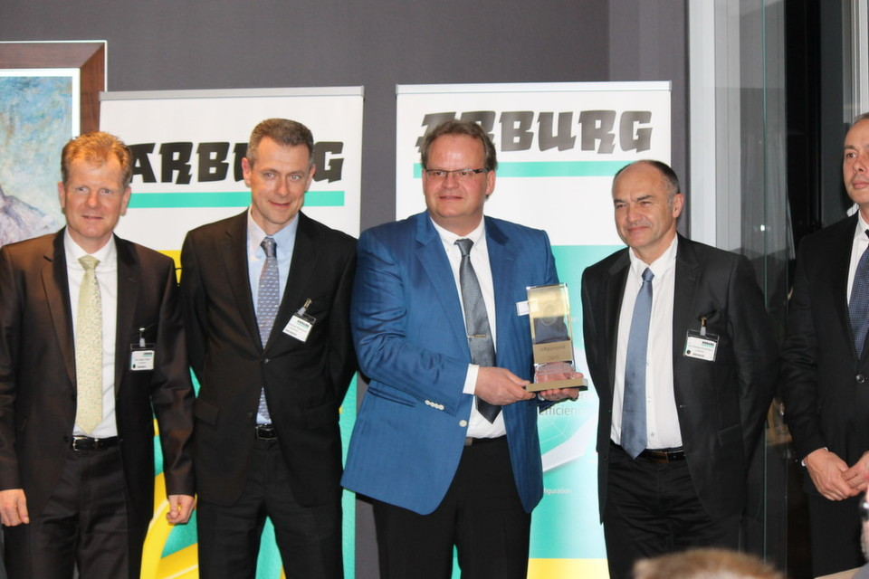 Smiling faces upon receipt of the Arburg energy efficiency award 2015: ARaymond representatives Jürgen Trefzer, François Raymond, Arburg Managing Partner Michael Hehl, Dominique Roullet-Revol and Tomas Cerman (from left to right).