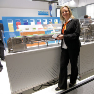 Sandvik's Gundula Eckhardt proudly shows the company's Rotoform 4G system running at the stand
