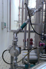 Wilden Hygienic Series AODD Pump in a mainstream pharmaceutical-process application. Observe the minimal floor space required compared to traditional horizontal pumps.