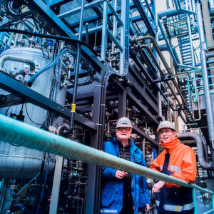 "Coke plant manager Peter Liszio (right) and Holger Thielert from ThyssenKrupp Industrial Solutions together initiated the joint project. ""What could be better than converting gas that is generated anyway into a new, saleable product,"" says Thielert."